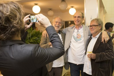 Rafael Urban taking a picture of Massimo Canevacci, Martin Grossmann and Leopold Nosek